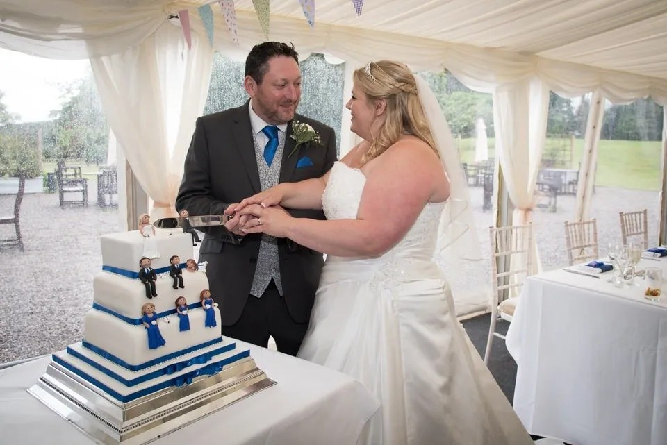 Cutting the wedding cake at Tortworth Court in Bristol