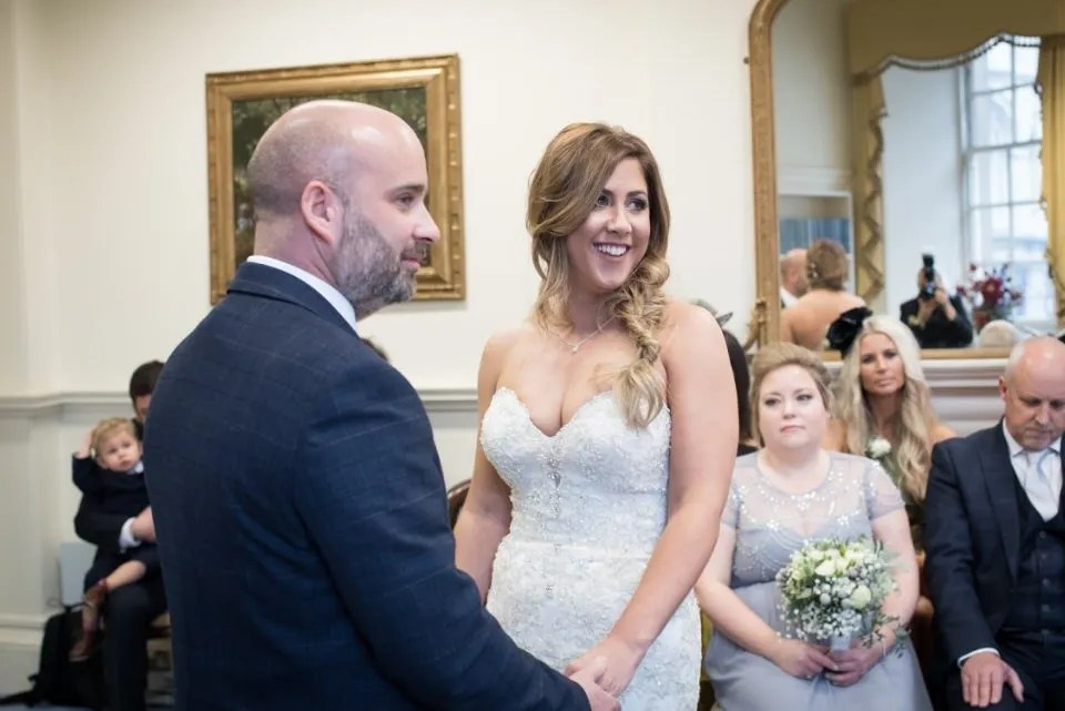 Bath Guildhall Abbey Room wedding couple saying vows