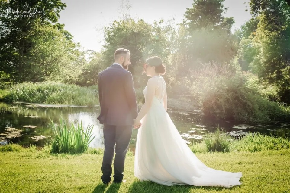 Crowcombe court wedding couple by the lake