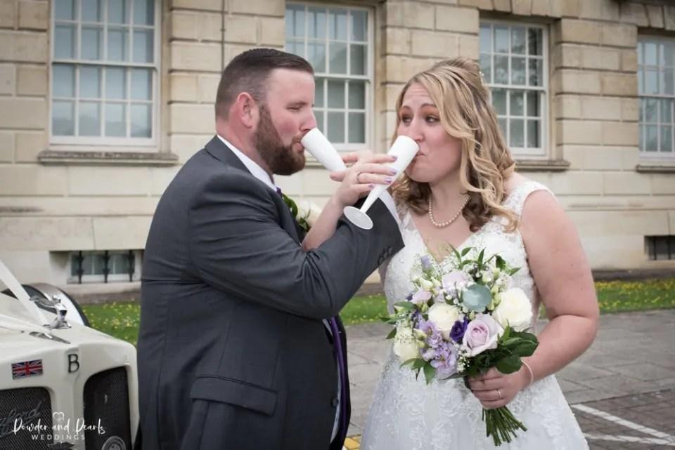Bride and groom toast at their Trowbridge registry office wedding