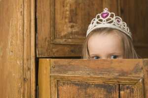 Close-up of a girl wearing a tiara and peeking