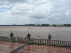 "{Nong Khai} Standing by the Mekong in Thailand, saying ""Hiiiii, Laos."""