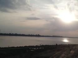 "{Laos} Standing by the Mekong, saying, ""Hiiiii, Thailand."""