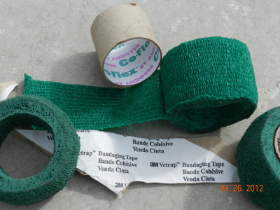 Mesh bandaging tape is self-adhesive and stretchy, making it a perfect for tying vines onto bamboo stakes