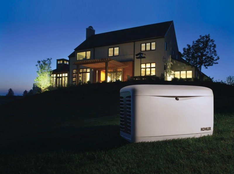 generator in front of house with lights on
