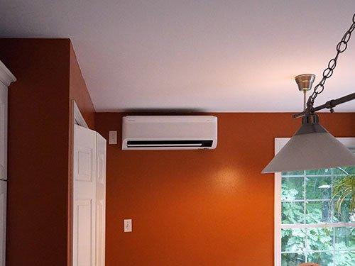 mini-split mounted on orange wall