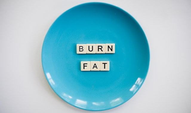"""""""burn fat"""" letters on plate"""
