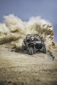 The 2016 Polaris RZR XP Turbo EPS having some fun in the sand.