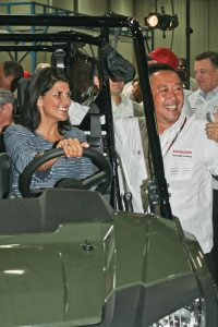 S.C. Gov. Nikki Haley and Honda's Katsumi Fujimoto are all smiles in the 2014 Pioneer. (Photo by Kevin Wing)