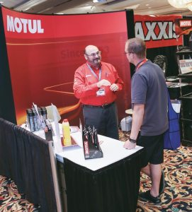 Dave Wolman, Motul president, was eager to explain the advantages of his brand's oils and chemicals.