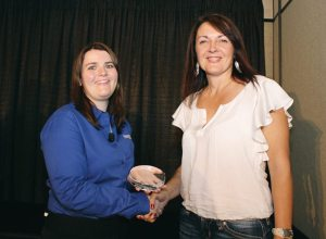 Belinda Lorenz of Rec-Tech Power Products in Alberta accepts the Power 50 Best in Class Award for Customer Service.