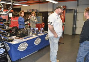 Jeremy Gilbert, sales manager at S&S Cycle, listens to a customer at the Backstage Pass to Service event at St. Paul Harley-Davidson.