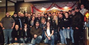 Employees of Adam Smith's Texas Harley-Davidson celebrate the dealership's 2013 Power 50 award, presented by Powersports Business.