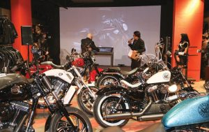 The Power Wall is the first-of-its-kind at any Harley-Davidson dealership, and is planned to serve as a model for future Harley dealerships. Asaf Jacobi, president/general manager of H-D of NYC, designed the concept behind the touch-screen kiosk and projection screen.