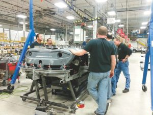 A group of Gibbs employees runs quality checks on a Quadski at the company's Auburn Hills, Mich., facility, where it employs a staff of about 150.