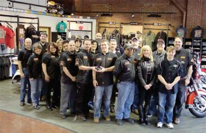 The staff at Cole Harley-Davidson, including general manager Chaz Cole, center, pose with their 2013 Power 50 award.