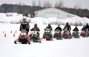 College students competing at the SAE Snowmobile Challenge got support from all four snowmobile manufacturers.