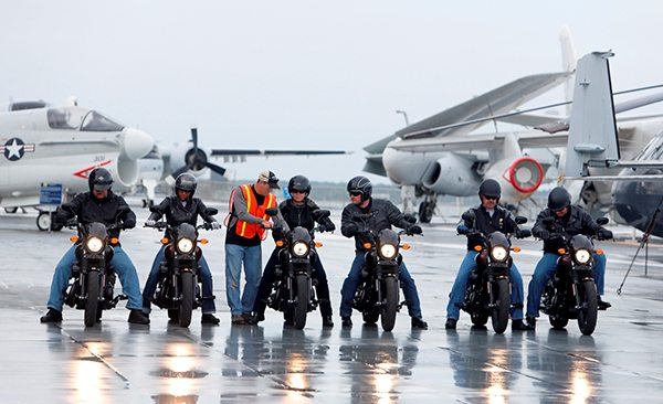 The scene from on the flight deck of the USS Yorktown while six veterans and active-duty military ride the H-D Street 500 as Harley-Davidson  with the H-D Street 500 as Harley-Davidson announced it is offering current and former U.S. military free Riding Academy motorcycle training in Mt. Pleasant, S.C., Wednesday, May 6, 2105.  (Mic Smith/AP Images for Harley-Davidson)
