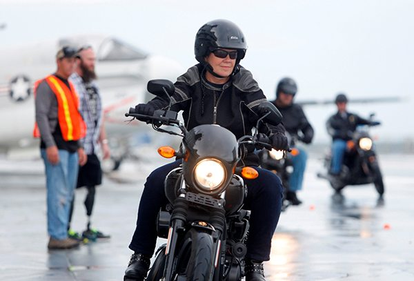Debi Cole, from James Island, S.C., rides the H-D Street 500 aboard the USS Yorktown Wednesday, May 6, 2015, in Mt. Pleasant, S.C., as Harley-Davidson announced it is offering free Riding Academy to all current and former U.S. Military.  (Mic Smith/AP Images for Harley-Davidson)