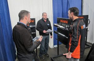 John Peck from Firebrand (right) shows off the company's newest products to reps at the Western Power Sports National Sales Meeting in Boise, Idaho.