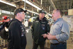 Ricky Carmichael (left) and Carey Hart (center), leaders of the RCH Soaring Eagle/Jimmy Johns/Suzuki Factory Racing Supercross team, with Rod Lopusnak, director and operations head for motorcycle/ATV sales at the Suzuki Manufacturing of America Corporation facility in Rome, Ga.