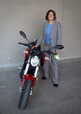 California Energy Commissioner Janea Scott with a 2015 Zero SR (PRNewsFoto/Zero Motorcycles)