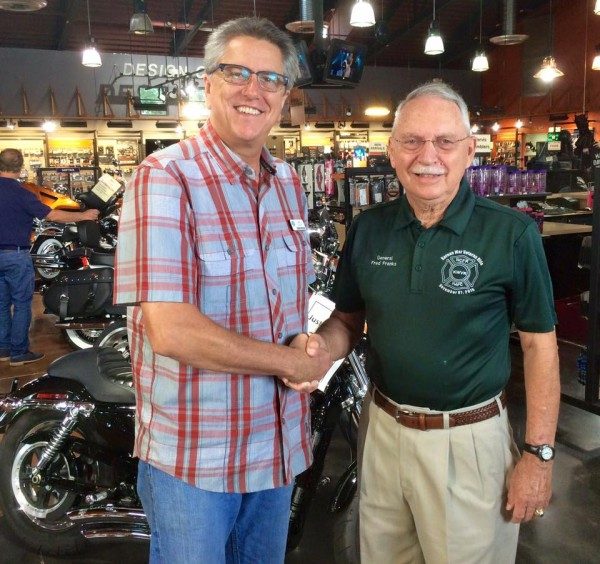 Naples Harley-Davidson general manager John Taber (left) and retired Gen. Frederick M. Franks, Jr.