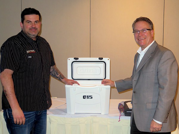 Mark Hendrix, general manager of Ray Price Harley-Davidson, won a cooler in a prize drawing by Federated Insurance's Scott Raymer.