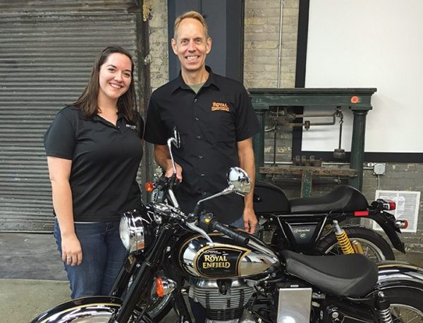 Kate Swanson and Royal Enfield North America president Rod Copes at the grand opening of the North American headquarters in Milwaukee.