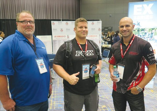 (From left) Dean Charrier, namesake of performance racing outfit Dean's Team, Trey Frame of Hidden Trails Motorsports in Charleston, West Virginia, and Sam Nehme of Broward Motorsports in Hollywood, Florida, caught up at the WaveRunner dealer meeting.