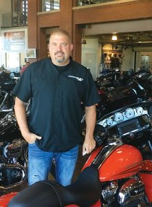 Doug Kamerer, A.D. Farrow's Minister of Culture, stands among new 2017 Harley-Davidson models at the Sunbury location. Kamerer is most excited about the new Harley engine unveilings and looks forward to increased interest from customers.