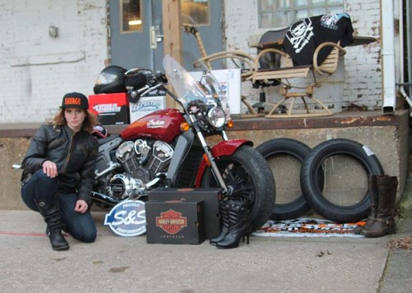The 2016 Garage-Girls Ultimate Biker Makeover winner poses with her swag collection.