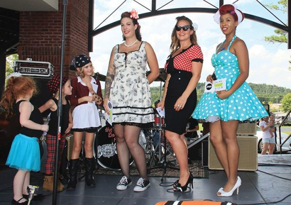 Among the activities at the annual Rockabilly Rumble, the dealership hosts a pin-up girl contest during the event.