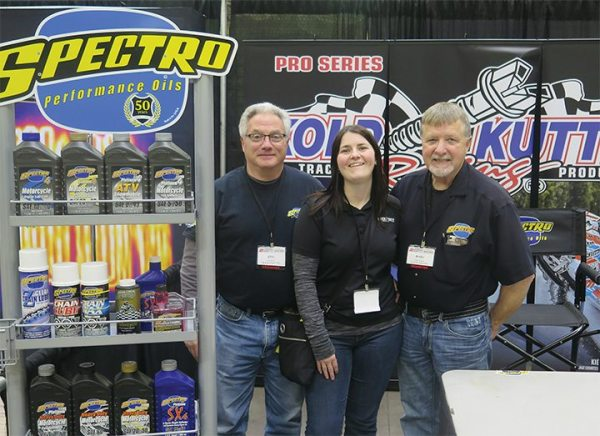 Ken Ciocci, left, and Marv Williams, respresenting Spectro Performance Oils, paused for a photo with PSB senior editor Liz Keener.