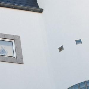 Деталь фасада дома на Vleminckveld