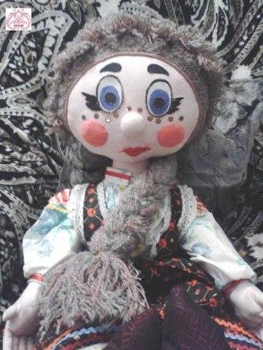 Оформление лица куклы в технике аппликация из ткани.