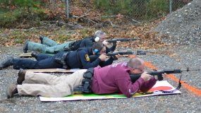 Sergeant Herrera, Officer Vestri, and Officer Smith take aim from a distance during firearms training.