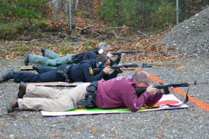 Sergeant Herrera, Officer Vestri, and Officer Smith take aim from a distance.