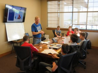 John discussing the fundamentals with 8th graders in this year's glider program at Falcon Aero Lab Charter School.