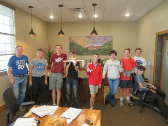John not only teaches these students in a classroom setting but also soaring in a glider!