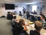 John learning with students at Falcon AeroLab