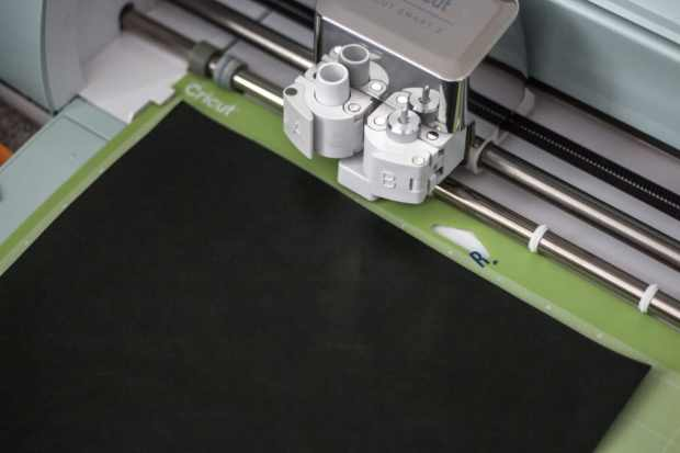 Make a DIY mousepad with your Cricut! All you need is some faux leather and clay!
