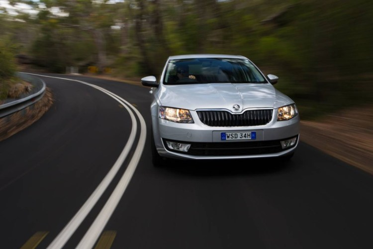 An RACQ survey shows Australian drivers warn others of speed traps by flashing their lights.