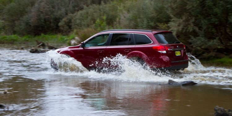 Subaru Outback driving in water