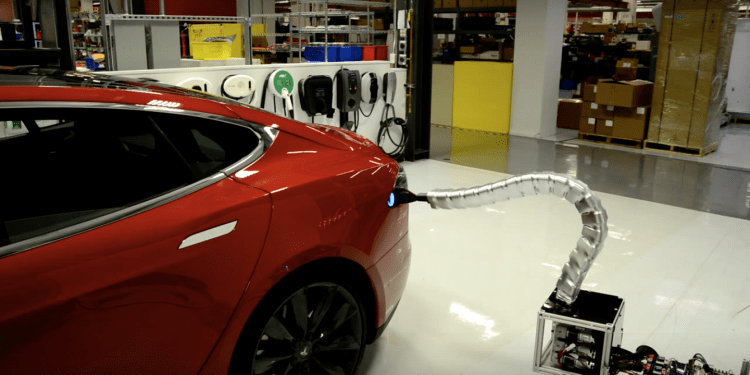 Tesla reveals prototype robotic car charger