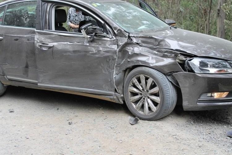 dirt road crashed car