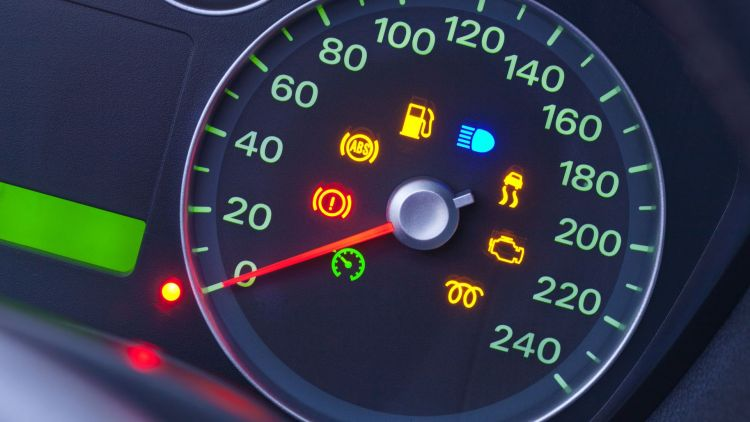 20219018 - a closeup on the dashboard of a modern car with many warning lights