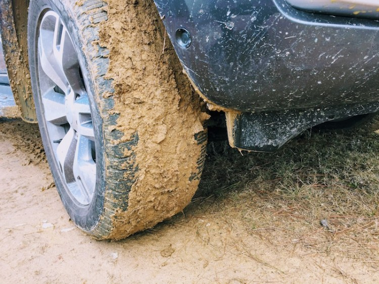 One issue with travelling on a wet muddy road is that your tyres can become caked with mud losing all grip. If you're not careful and the track is sloping to one side, these mud-caked tyres can cause you to slip sideways on the track… Always use low-range in thick mud like this, and dropping the tyre pressures down to around 18-20psi is also recommended, but only if you have a way to reinflate them.