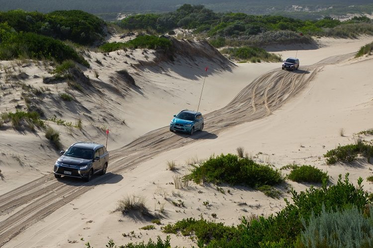 Mitsubishis navigating between the dunes. Photo by Robert Pepper / Practical Motoring.