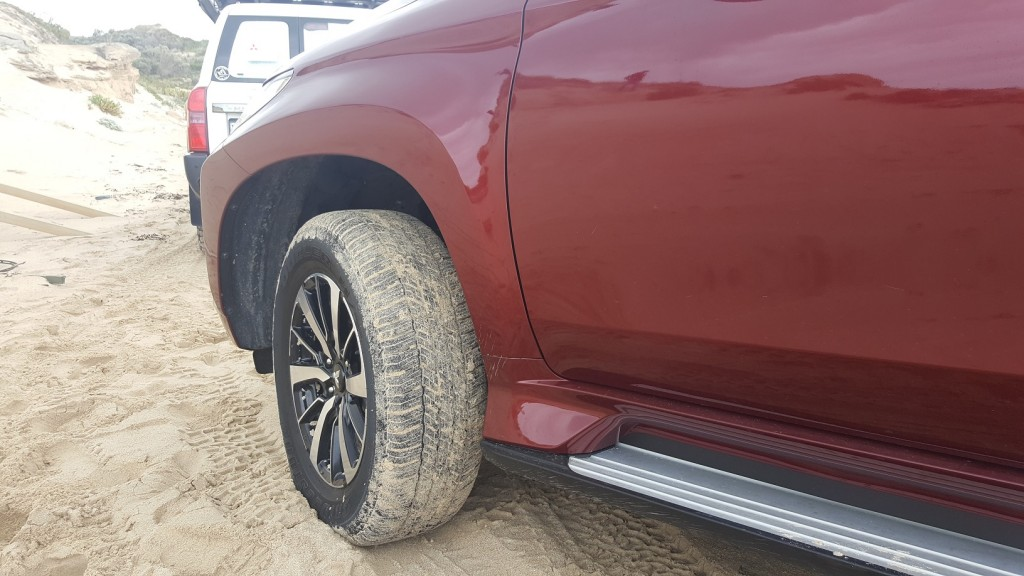 The Pajero's road tyres work well on the sand